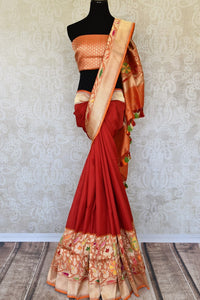 Buy traditional red Banarasi silk saree online in USA with floral zari border. The saree is a rich choice for a traditional wedding look. If you are looking for Indian designer silk sarees, Banarasi sarees in USA, then Pure Elegance clothing store is your one-stop solution, shop now.-full view
