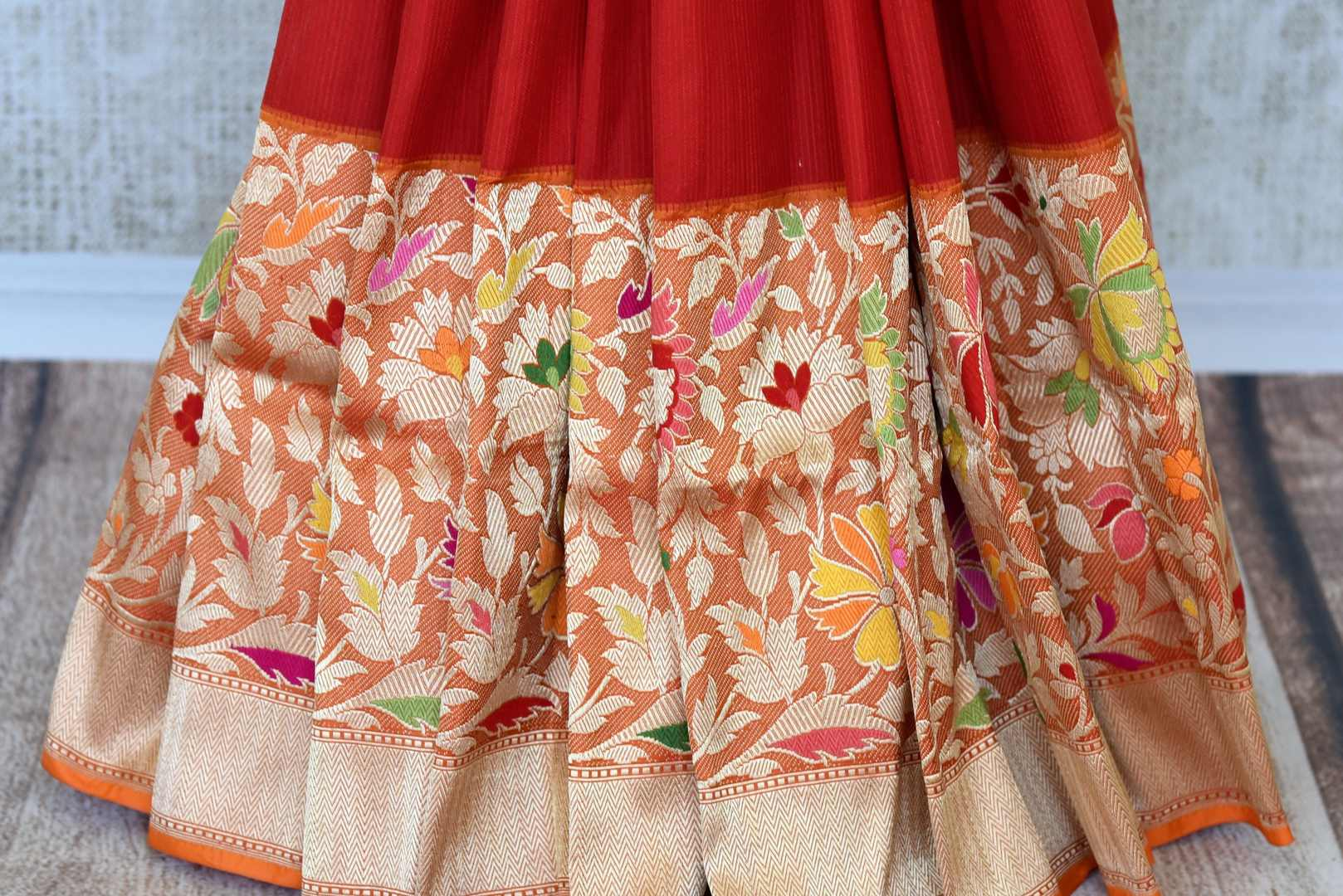 Buy traditional red Banarasi silk saree online in USA with floral zari border. The saree is a rich choice for a traditional wedding look. If you are looking for Indian designer silk sarees, Banarasi sarees in USA, then Pure Elegance clothing store is your one-stop solution, shop now.-pleats