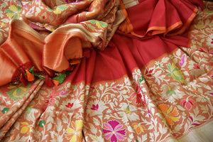 Buy traditional red Banarasi silk saree online in USA with floral zari border. The saree is a rich choice for a traditional wedding look. If you are looking for Indian designer silk sarees, Banarasi sarees in USA, then Pure Elegance clothing store is your one-stop solution, shop now.-details