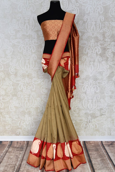 Buy brown check Banarasi silk saree online in USA with red zari border. The saree is an elegant choice for parties and special occasions. If you are looking for Indian designer sarees, Banarasi sarees in USA, then Pure Elegance clothing store is your one-stop solution, shop now.-full view
