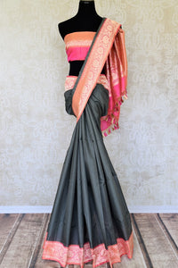 Perk up your formal soiree look in this designer grey tussar banarsi silk saree. It comes with a gorgeous pink zari pallu and contrasting pink zari blouse. Style this ensemble to the formal soiree or festivities. Shop designer silk sarees, printed sarees, ikkat saris online or visit Pure Elegance store in USA.-full view