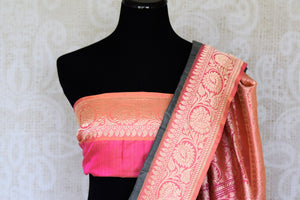 Perk up your formal soiree look in this designer grey tussar banarsi silk saree. It comes with a gorgeous pink zari pallu and contrasting pink zari blouse. Style this ensemble to the formal soiree or festivities. Shop designer silk sarees, printed sarees, ikkat saris online or visit Pure Elegance store in USA.-blouse pallu