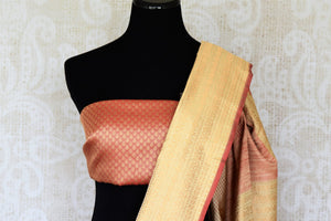 Embrace the traditional banarsi silk sari in white and red hues. Slip into this vibrant designer saree to steal the hearts away at weddings and parties. Pair this with red and gold embroidered blouse. Shop such handloom sari, silk saree, printed sarees online or visit Pure Elegance store, USA. -blouse pallu