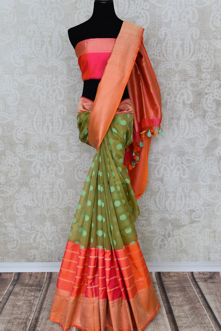 Buy green organza Banarasi saree online in USA with pink zari border. The saree is an elegant choice for parties and special occasions. If you are looking for Indian designer sarees, Banarasi silk sarees in USA, then Pure Elegance clothing store is your one-stop solution, shop now.-full view