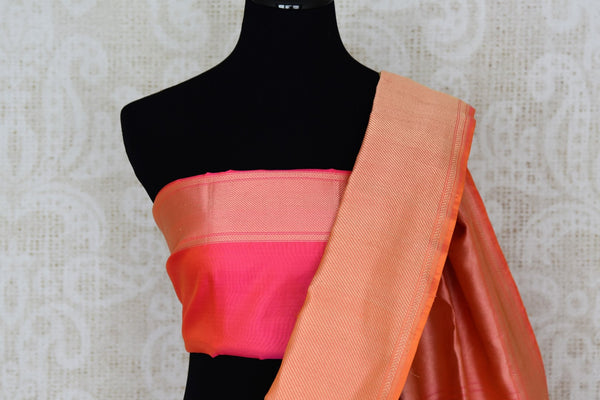 Buy green organza Banarasi saree online in USA with pink zari border. The saree is an elegant choice for parties and special occasions. If you are looking for Indian designer sarees, Banarasi silk sarees in USA, then Pure Elegance clothing store is your one-stop solution, shop now.-blouse pallu
