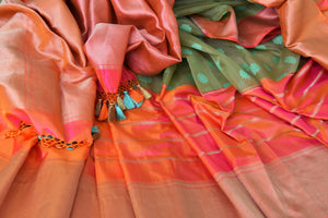 Buy green organza Banarasi saree online in USA with pink zari border. The saree is an elegant choice for parties and special occasions. If you are looking for Indian designer sarees, Banarasi silk sarees in USA, then Pure Elegance clothing store is your one-stop solution, shop now.-details