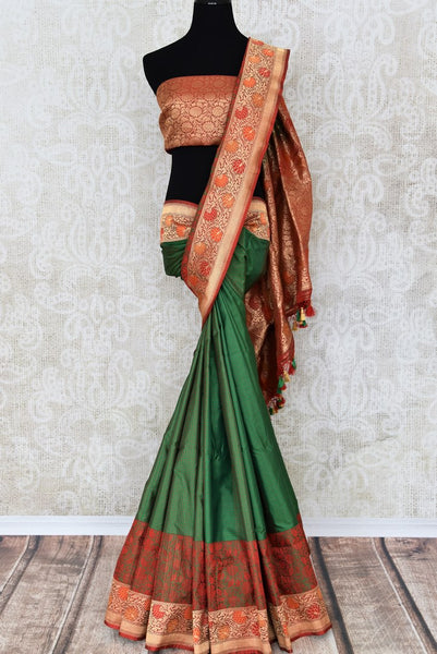 Buy dark green Banarasi silk saree online in USA with floral zari border. The saree is a rich drape for weddings and special occasions. If you are looking for Indian designer sarees, Banarasi silk sarees in USA, then Pure Elegance clothing store is your one-stop solution, shop now.-full view