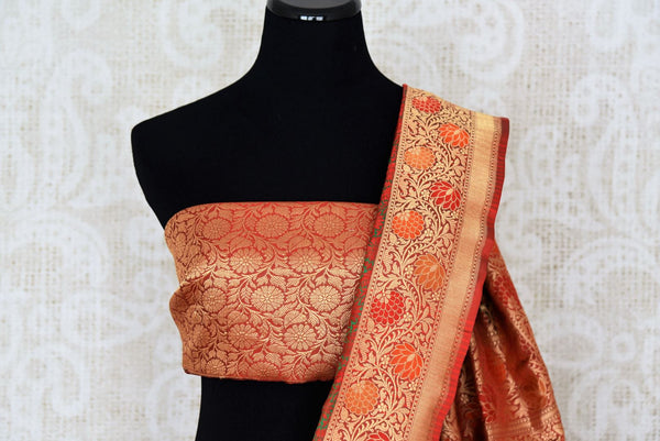 Buy dark green Banarasi silk saree online in USA with floral zari border. The saree is a rich drape for weddings and special occasions. If you are looking for Indian designer sarees, Banarasi silk sarees in USA, then Pure Elegance clothing store is your one-stop solution, shop now.-blouse pallu