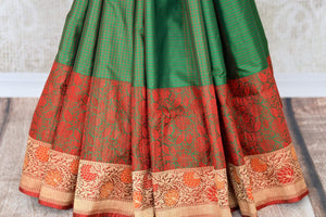 Buy dark green Banarasi silk saree online in USA with floral zari border. The saree is a rich drape for weddings and special occasions. If you are looking for Indian designer sarees, Banarasi silk sarees in USA, then Pure Elegance clothing store is your one-stop solution, shop now.-pleats