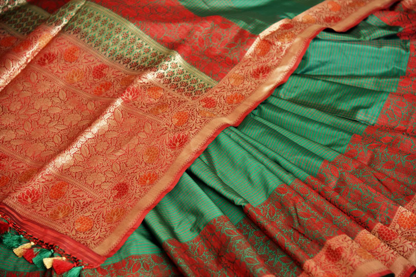 Buy dark green Banarasi silk saree online in USA with floral zari border. The saree is a rich drape for weddings and special occasions. If you are looking for Indian designer sarees, Banarasi silk sarees in USA, then Pure Elegance clothing store is your one-stop solution, shop now.-details
