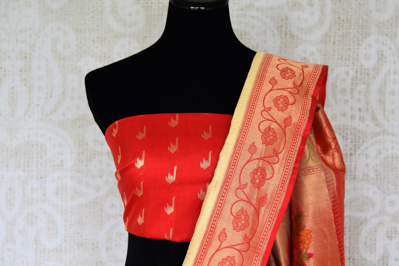 Classics like this white banarasi silk saree comes with a contrasting red designer buta work blouse and heavily embroidered red pallu. The graceful sari can be worn at upscale parties, weddings and festivities. Shop designer printed saris, ikkat saris, handwoven sarees online or visit Pure Elegance store, USA. -blouse pallu