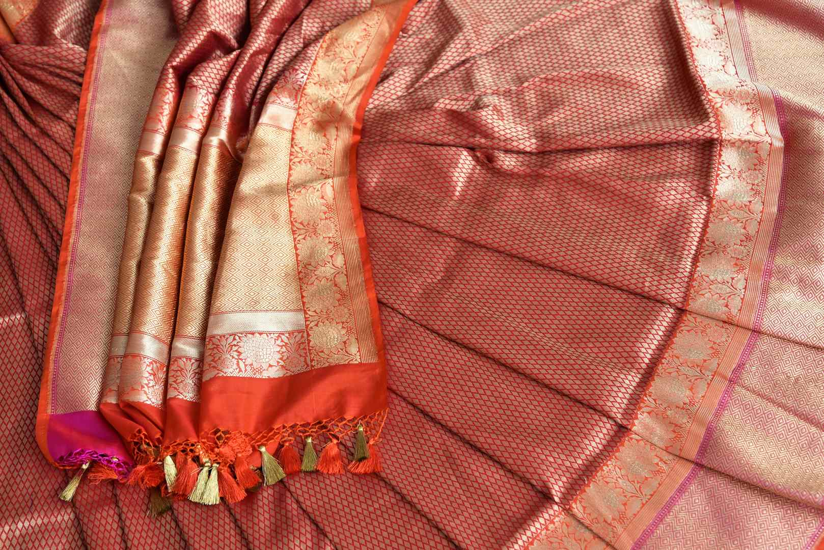 Buy traditional red Banarasi silk saree online in USA with overall zari work. The saree is a rich drape for weddings and special occasions. If you are looking for Indian designer sarees, Banarasi silk saris in USA, then Pure Elegance clothing store is your one-stop solution, shop now.-details