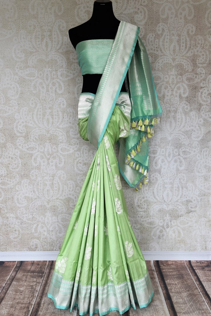 Graceful green banarsi silk saree featuring intricate buta work all over is a perfect way to unleash your bright side at parties, weddings and events. this stunning silk saree with zari work and heavily woven pallu. Shop handcrafted silk sarees, printed saris, embroidered sarees online or visit Pure Elegance, USA-full view