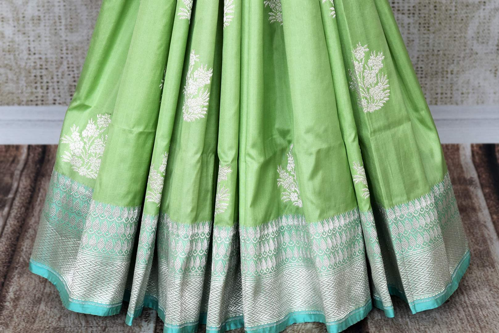 Graceful green banarsi silk saree featuring intricate buta work all over is a perfect way to unleash your bright side at parties, weddings and events. this stunning silk saree with zari work and heavily woven pallu. Shop handcrafted silk sarees, printed saris, embroidered sarees online or visit Pure Elegance, USA-pleats
