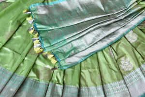 Graceful green banarsi silk saree featuring intricate buta work all over is a perfect way to unleash your bright side at parties, weddings and events. this stunning silk saree with zari work and heavily woven pallu. Shop handcrafted silk sarees, printed saris, embroidered sarees online or visit Pure Elegance, USA-details