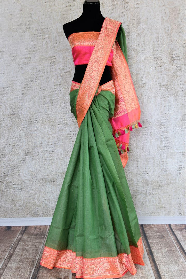 Buy ethnic green Banarasi silk saree with zari border online in USA. The saree is a perfect drape for a traditional Indian look at weddings and special occasions. Spoil yourself with an exquisite collection of Indian Banarasi sarees, silk sarees in USA available at Pure Elegance Indian clothing store. -full view