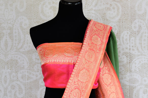 Buy ethnic green Banarasi silk saree with zari border online in USA. The saree is a perfect drape for a traditional Indian look at weddings and special occasions. Spoil yourself with an exquisite collection of Indian Banarasi sarees, silk sarees in USA available at Pure Elegance Indian clothing store. -blouse pallu