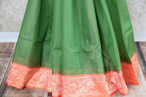Buy ethnic green Banarasi silk saree with zari border online in USA. The saree is a perfect drape for a traditional Indian look at weddings and special occasions. Spoil yourself with an exquisite collection of Indian Banarasi sarees, silk sarees in USA available at Pure Elegance Indian clothing store. -pleats