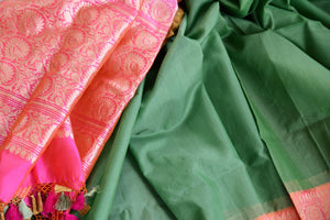 Buy ethnic green Banarasi silk saree with zari border online in USA. The saree is a perfect drape for a traditional Indian look at weddings and special occasions. Spoil yourself with an exquisite collection of Indian Banarasi sarees, silk sarees in USA available at Pure Elegance Indian clothing store. -details