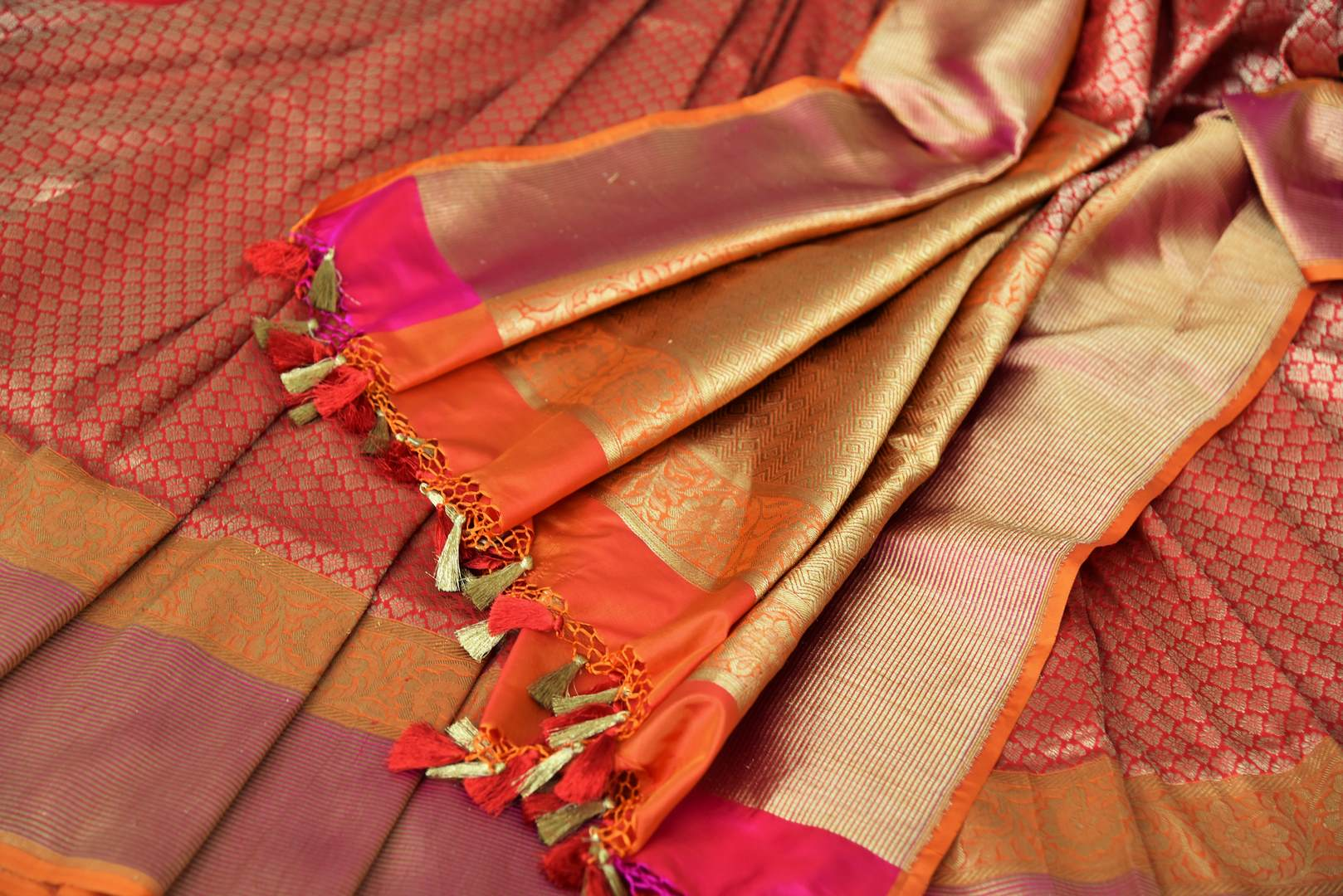 Buy beautiful red Banarasi silk sari online in USA with rich zari work. The saree is a rich drape for weddings and special occasions. If you are looking for Indian designer silk sarees, Banarasi silk saris in USA, then Pure Elegance clothing store is your one-stop solution, shop now.-details