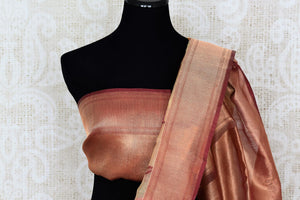 Shop beige kora tissue silk saree online in USA with copper cplor border. Make your ethnic wardrobe rich with traditional Indian silk saris available at Pure Elegance exclusive clothing store in USA or shop online.-blouse pallu