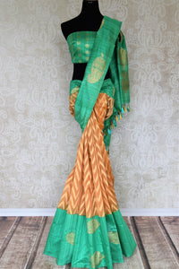 Drape this gorgeous orange organza banarsi silk saree to fancy parties, gala soirees, weddings etc. It comes in a striking green contrast with buta work and paired with visually appealing green buta work blouse. Shop designer silk sari, printed saree, embroidered saree online or visit Pure Elegance store, USA. -full view