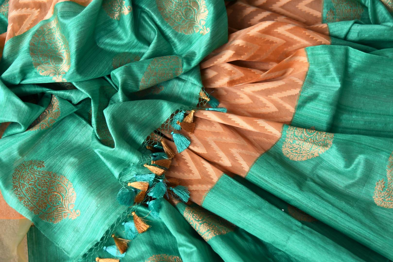 Drape this gorgeous orange organza banarsi silk saree to fancy parties, gala soirees, weddings etc. It comes in a striking green contrast with buta work and paired with visually appealing green buta work blouse. Shop designer silk sari, printed saree, embroidered saree online or visit Pure Elegance store, USA. -details