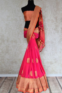Buy online bright pink Banarasi silk saree in USA with zari border. The saree is a rich drape for a traditional wedding look. If you are looking for Indian handloom sarees, Benarasi  sarees in USA, then Pure Elegance is the place for you. Shop online or visit our exclusive fashion store in USA.-full view