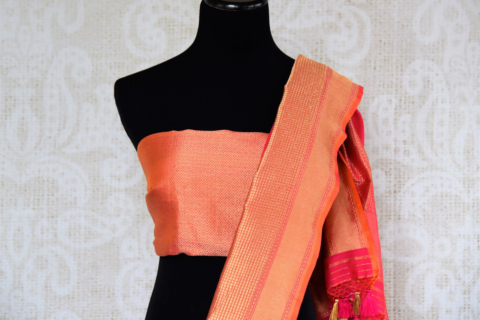 Buy online bright pink Banarasi silk saree in USA with zari border. The saree is a rich drape for a traditional wedding look. If you are looking for Indian handloom sarees, Benarasi  sarees in USA, then Pure Elegance is the place for you. Shop online or visit our exclusive fashion store in USA.-blouse pallu