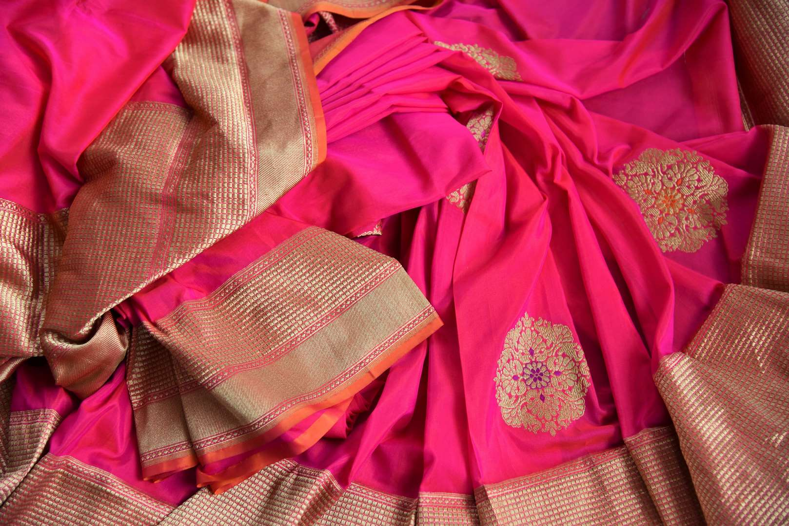 Buy online bright pink Banarasi silk saree in USA with zari border. The saree is a rich drape for a traditional wedding look. If you are looking for Indian handloom sarees, Benarasi  sarees in USA, then Pure Elegance is the place for you. Shop online or visit our exclusive fashion store in USA.-details