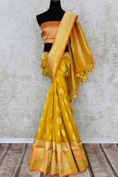 Buy mustard yellow organza Banarasi saree online in USA with zari buta. The saree is a rich drape for weddings and special occasions. If you are looking for Indian designer silk sarees, Banarasi sarees in USA, then Pure Elegance clothing store is your one-stop solution, shop now.-full view