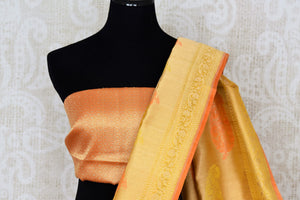 Buy mustard yellow organza Banarasi saree online in USA with zari buta. The saree is a rich drape for weddings and special occasions. If you are looking for Indian designer silk sarees, Banarasi sarees in USA, then Pure Elegance clothing store is your one-stop solution, shop now.-blouse pallu