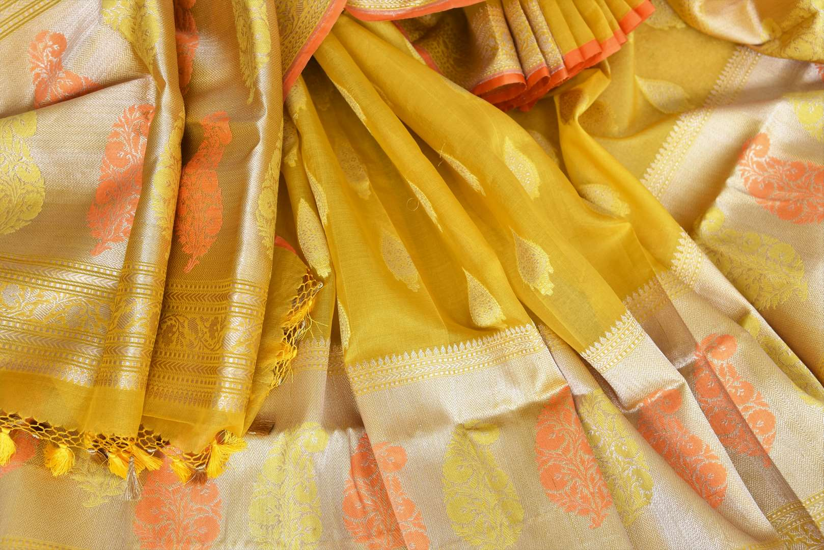 Buy mustard yellow organza Banarasi saree online in USA with zari buta. The saree is a rich drape for weddings and special occasions. If you are looking for Indian designer silk sarees, Banarasi sarees in USA, then Pure Elegance clothing store is your one-stop solution, shop now.-details