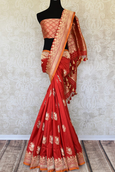 Buy rich red color Banarasi silk saree online in USA with zari buta and border. The saree is an enchanting drape for weddings and special occasions. If you are looking for Indian designer silk sarees, Banarasi sarees in USA, then Pure Elegance clothing store is your one-stop solution, shop now.-full view