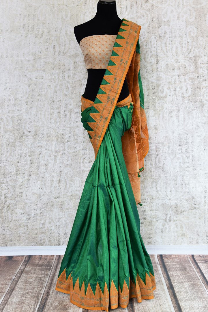 Buy green raw silk saree with jamdani border online in USA. The saree is a perfect drape for a traditional Indian look at special occasions. Spoil yourself with an exquisite collection of Indian sarees in USA available at Pure Elegance Indian clothing store. -full view