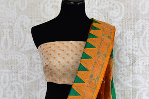 Buy green raw silk saree with jamdani border online in USA. The saree is a perfect drape for a traditional Indian look at special occasions. Spoil yourself with an exquisite collection of Indian sarees in USA available at Pure Elegance Indian clothing store. -blouse pallu