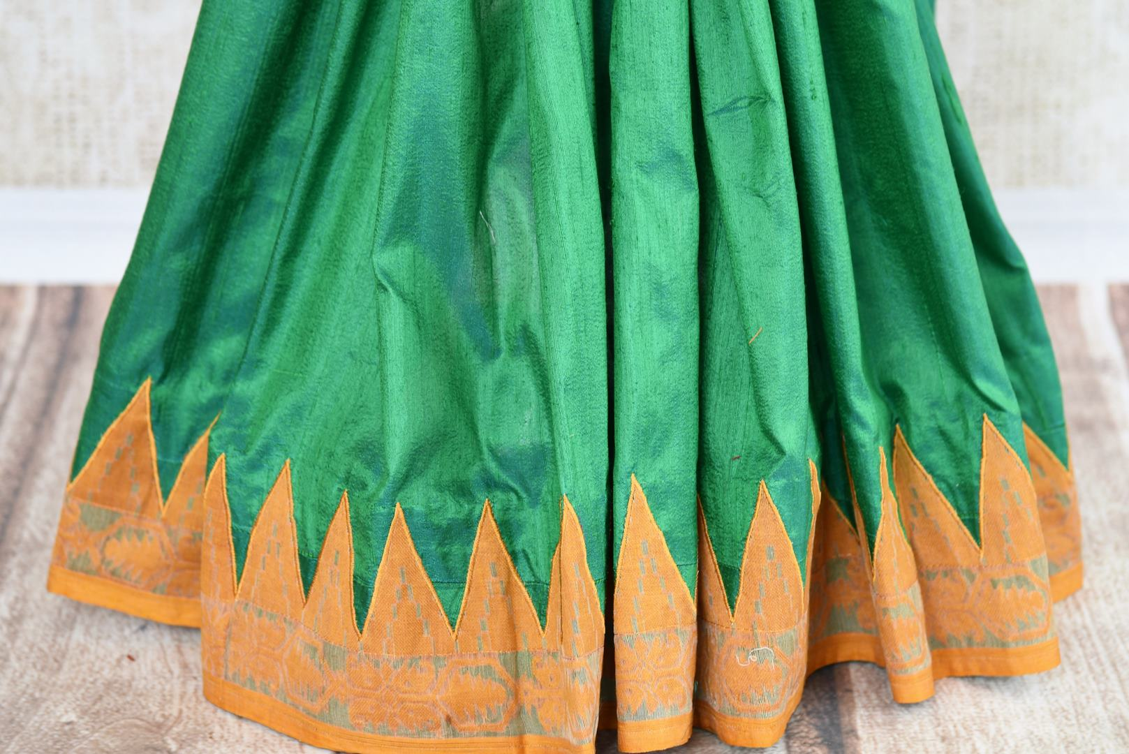 Buy green raw silk saree with jamdani border online in USA. The saree is a perfect drape for a traditional Indian look at special occasions. Spoil yourself with an exquisite collection of Indian sarees in USA available at Pure Elegance Indian clothing store. -pleats