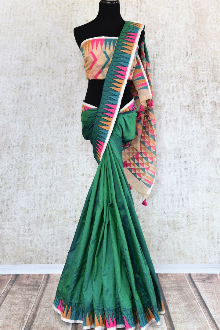 Buy bright green raw silk saree with jamdani weave border online in USA. The saree is a perfect drape for a traditional Indian look at special occasions. Spoil yourself with an exquisite collection of Indian silk sarees in USA available at Pure Elegance Indian clothing store. -full view