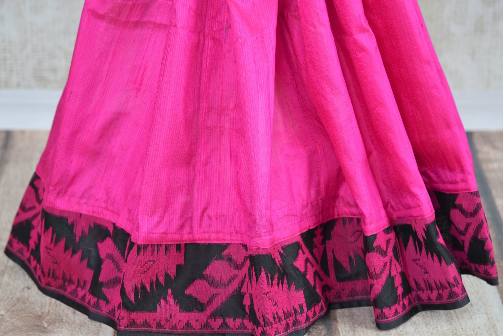 Buy pink raw silk saree with dhakai jamdani weave online in USA. The saree is a perfect drape for a traditional Indian look at special occasions. Spoil yourself with an exquisite collection of Indian handloom sarees in USA available at Pure Elegance Indian clothing store. -pleats