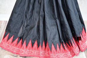 Buy black raw silk saree with jamdani weave pallu online in USA. The saree is a perfect drape for a traditional Indian look at special occasions. Spoil yourself with an exquisite collection of Indian handloom sarees in USA available at Pure Elegance Indian clothing store. -pleats