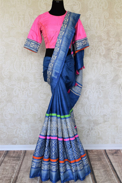 This exclusively designed Blue Tussar silk sari with tribal prints is a summer staple for women. It comes with trendy tassel drop pallu and a beautiful contrasting pink blouse. Shop handcrafted silk saris, Indian designer sarees, kanjeevaram silk saris online or visit Pure Elegance store in USA. -full view