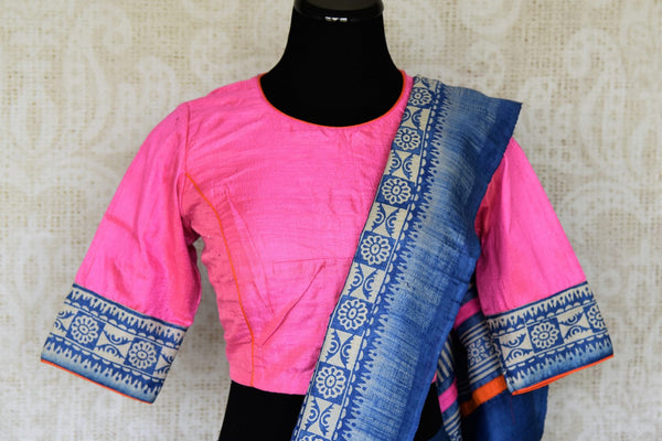 This exclusively designed Blue Tussar silk sari with tribal prints is a summer staple for women. It comes with trendy tassel drop pallu and a beautiful contrasting pink blouse. Shop handcrafted silk saris, Indian designer sarees, kanjeevaram silk saris online or visit Pure Elegance store in USA. -blouse pallu