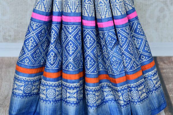 This exclusively designed Blue Tussar silk sari with tribal prints is a summer staple for women. It comes with trendy tassel drop pallu and a beautiful contrasting pink blouse. Shop handcrafted silk saris, Indian designer sarees, kanjeevaram silk saris online or visit Pure Elegance store in USA. -pleats