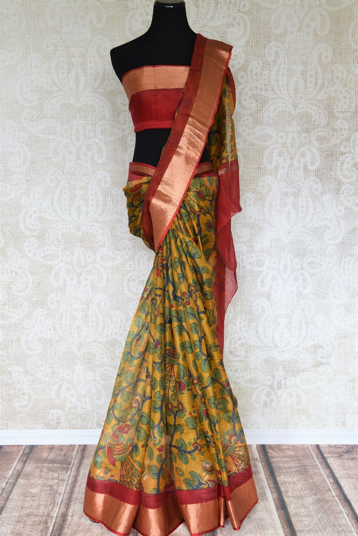 Shop the stunning orange kota silk with zardozi work wedding saree. Designer blouse in red color with zari work and handprinted motifs on this graceful sari are pleasing to the eye. Shop handwoven silk sarees, designer silk saris, banarsi silk sarees, chanderi sarees online or visit Pure Elegance store in USA. -full view