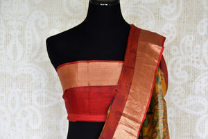 Shop the stunning orange kota silk with zardozi work wedding saree. Designer blouse in red color with zari work and handprinted motifs on this graceful sari are pleasing to the eye. Shop handwoven silk sarees, designer silk saris, banarsi silk sarees, chanderi sarees online or visit Pure Elegance store in USA. -blouse pallu