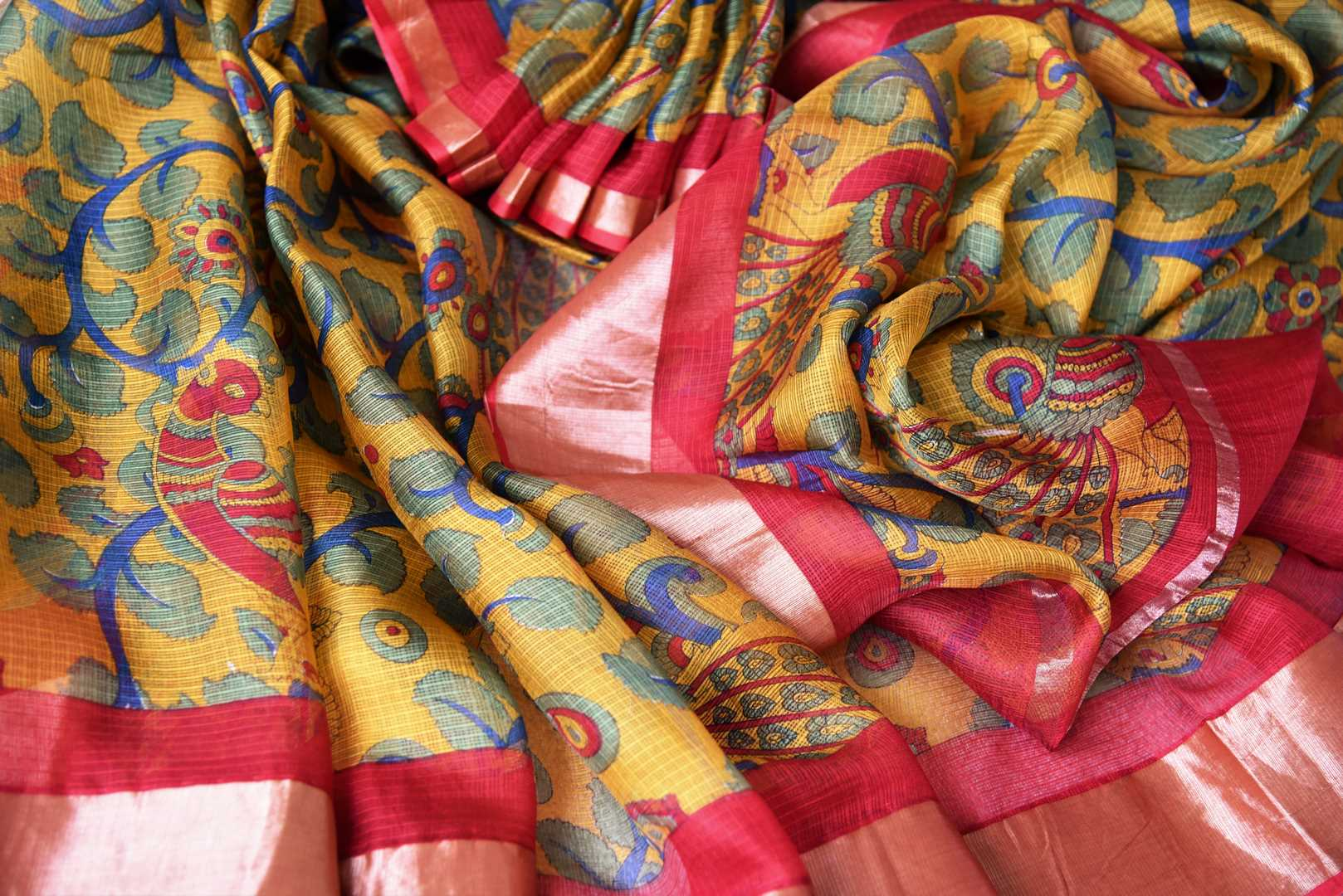 Shop the stunning orange kota silk with zardozi work wedding saree. Designer blouse in red color with zari work and handprinted motifs on this graceful sari are pleasing to the eye. Shop handwoven silk sarees, designer silk saris, banarsi silk sarees, chanderi sarees online or visit Pure Elegance store in USA. -details