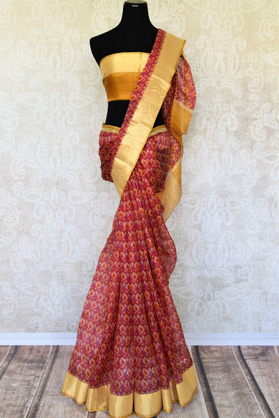 Treat yourself with the charming quintessential summer staple kota silk sari. A perfect blush pink with floral prints and effortless flow, style this sari with contrast yellow and zari blouse to work or formal events. Shop designer silk saris, embroidered sarees, ikkat sari online or visit Pure Elegance store, USA.-full view