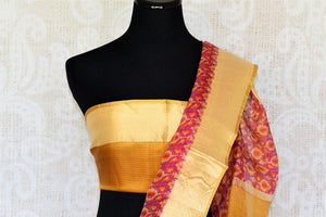 Treat yourself with the charming quintessential summer staple kota silk sari. A perfect blush pink with floral prints and effortless flow, style this sari with contrast yellow and zari blouse to work or formal events. Shop designer silk saris, embroidered sarees, ikkat sari online or visit Pure Elegance store, USA.-blouse pallu