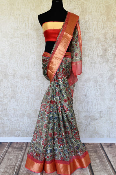 Escape the monotony in our green floral handprinted kota silk saree. The serene sari with a red zari embroidery contrast on the border is an absolute bliss. Style this sari with a red zari detailed blouse. Shop handcrafted silk sarees, kanjeevaram silk saris, printed sarees online or visit Pure Elegance store, USA. -full view
