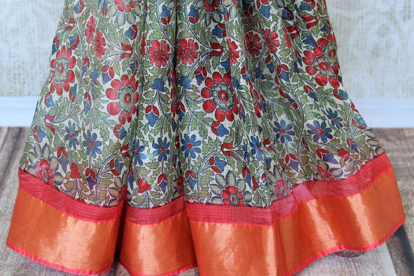 Escape the monotony in our green floral handprinted kota silk saree. The serene sari with a red zari embroidery contrast on the border is an absolute bliss. Style this sari with a red zari detailed blouse. Shop handcrafted silk sarees, kanjeevaram silk saris, printed sarees online or visit Pure Elegance store, USA. -pleats